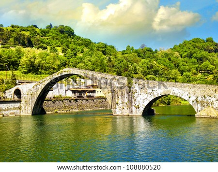 Ponte della Maddalena across the Serchio. Tuscany. Bridge of the Devil, Italy - stock photo