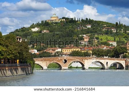 Ponte Pietra and Adige River - Verona Italy / Ponte Pietra (Stone bridge) - 1st century B.C. - the oldest Roman monument in Verona (UNESCO world heritage site) and the Adige river, Veneto, Italy - stock photo