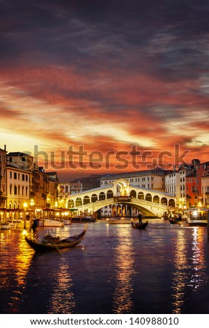 Ponte Rialto and gondola at sunset in Venice, Italy (landscape orientation also available) - stock photo