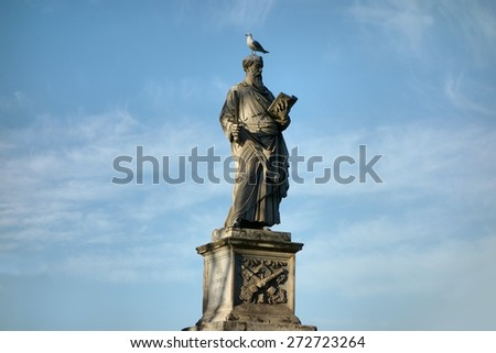 Ponte Sant Angelo birdge statue of Saint Paul by 16th century artist Paolo Romano in Rome, Italy,  - stock photo