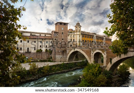 Ponte Sant Angelo (St. Angelo Bridge ) and the Trastevere district in Rome with River Tiber, Italy - stock photo