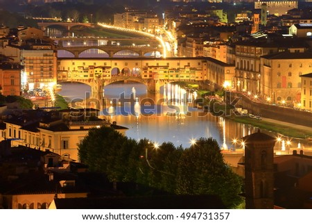 Ponte Vecchio and Arno river illuminated by night, Florence, Tuscany, Italy