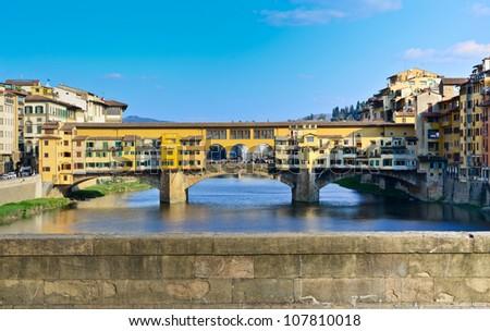 Ponte Vecchio bridge across Arno river in Florence, Italy - stock photo