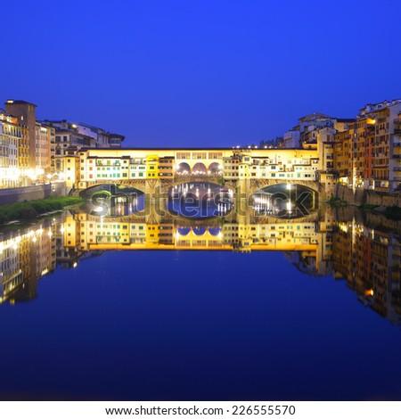 Ponte Vecchio bridge in Florence at night, Italy - stock photo