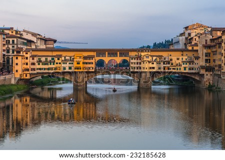 Ponte Vecchio bridge in Florence at sunset, Italy