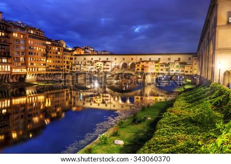 Ponte Vecchio bridge in Florence, Italy. Arno River at night. Tuscany - stock photo