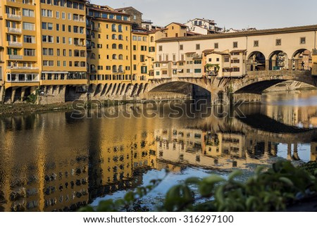Ponte Vecchio in Florence reflected in the river Arno