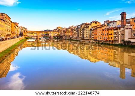 Ponte Vecchio, old bridge, medieval landmark on Arno river and reflection. Florence, Tuscany, Italy. - stock photo
