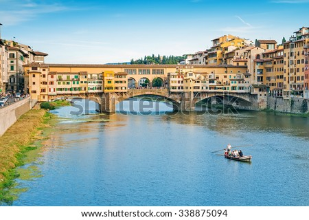 Ponte Vecchio on the river Arno in Florence, Italy - stock photo