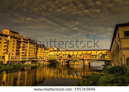Ponte Vecchio over Arno river in Florence, Italy. - stock photo