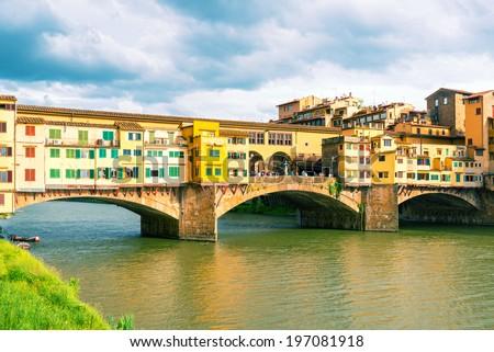 Ponte Vecchio over Arno river in Florence, Italy. Vintage photo. - stock photo
