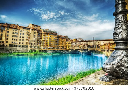 Ponte Vecchio seen from Arno bank in Florence, Italy - stock photo