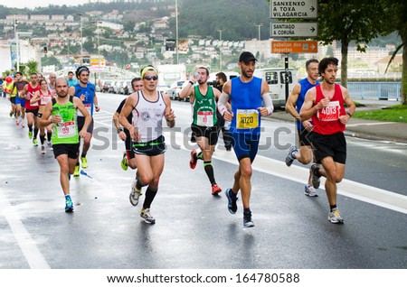PONTEVEDRA - OCTOBER 20: Detail of the participants in the XVII Half Marathon held on the street circuit in the village of Pontevedra, on October 20, 2013.
