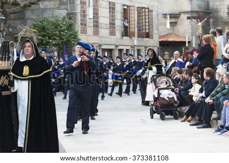 PONTEVEDRA, SPAIN - APRIL 2, 2015: Detail of one of the religious brotherhoods parading in a procession in celebration of Easter in the historic center of the city.