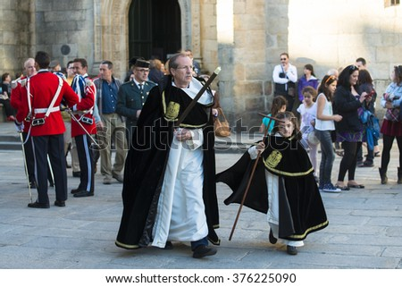 PONTEVEDRA, SPAIN - APRIL 3, 2015: Members of a military band and members of a religious brotherhood, wait for the start of the Holy Week processions. - stock photo