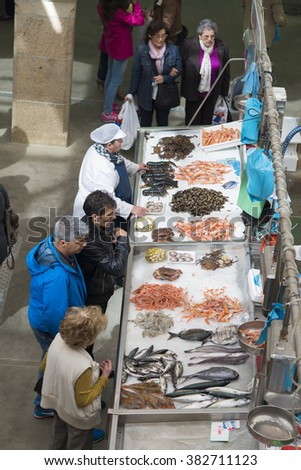 PONTEVEDRA, SPAIN - APRIL 11, 2015: Stalls selling fresh seafood, in the central market of the city.
