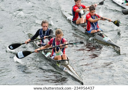 PONTEVEDRA, SPAIN - AUGUST 3, 2014: Extreme athletes participating in the Spain Copa Canoe Marathon in Lerez River, to qualify for the World Championship.