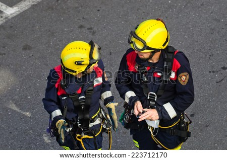 Pontevedra, SPAIN - JUNE 17, 2014: A pair of firemen during an operation to rescue the corpse of a migrant found dead of natural causes at his home. - stock photo
