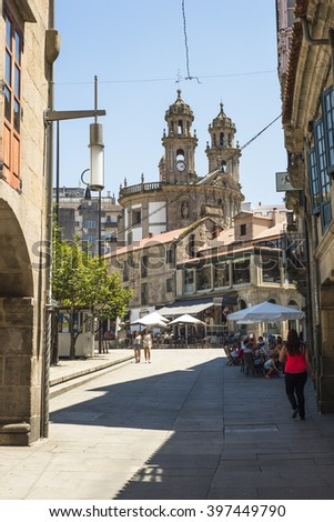 PONTEVEDRA, SPAIN - JUNE 27, 2015: Street historical district of the city, with the church of the Pilgrim Virgin in the background. - stock photo