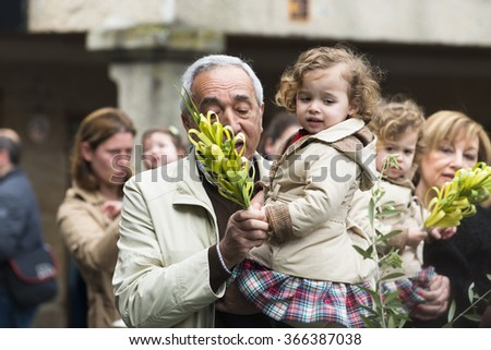 PONTEVEDRA, SPAIN - MARCH 29, 2015: Detail of person participating in the celebration of Palm Sunday before Easter. - stock photo