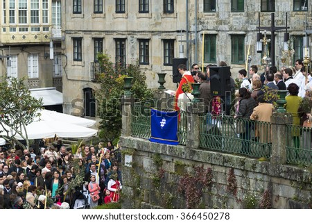PONTEVEDRA, SPAIN - MARCH 29, 2015: Detail of person participating in the celebration of Palm Sunday before Easter, waiting for the blessing of olive branches and palm.. - stock photo