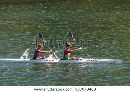 PONTEVEDRA, SPAIN - MAY 17, 2015: Detail of some participants in the Spain Championship Canoe Marathon, held in the river running through the city. - stock photo