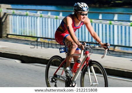 PONTEVEDRA, SPAIN - MAY 31, 2014: Detail of the participants in the Duathlon World Championships in the Junior Women's category, in the streets of the city, free and public.