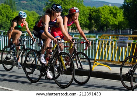 PONTEVEDRA, SPAIN - MAY 31, 2014: Detail of the participants in the Duathlon World Championships in the Junior Women's category, by the street of the city.