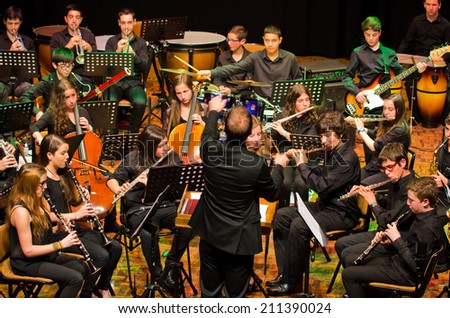 """PONTEVEDRA, SPAIN - MAY 4, 2014: Performance of young musical band of Pontevedra during the """"Rock in the Theatre"""", public and free admission concert, held at the Principal Theatre of the city. - stock photo"""