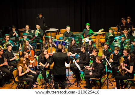 "PONTEVEDRA, SPAIN - MAY 4, 2014: Performance of young musical band Pontevedra during the ""Rock in the Theatre"" concert free and public, held at the Principal Theatre of the city. - stock photo"