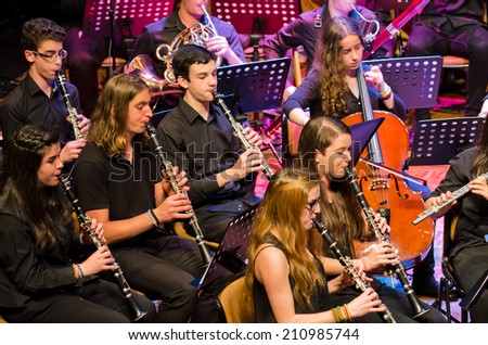 "PONTEVEDRA, SPAIN - MAY 4, 2014: Performance of young musical band Pontevedra during the ""Rock in the Theatre"", free and public concert, held at the Principal Theatre of the city. - stock photo"