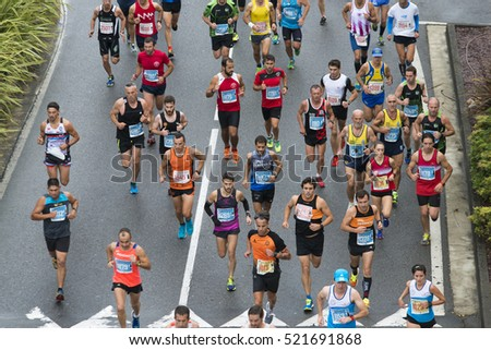 PONTEVEDRA, SPAIN - OCTOBER 16, 2016: Detail of participants in Popular Half Marathon City of Pontevedra 2016, through the streets of the city.