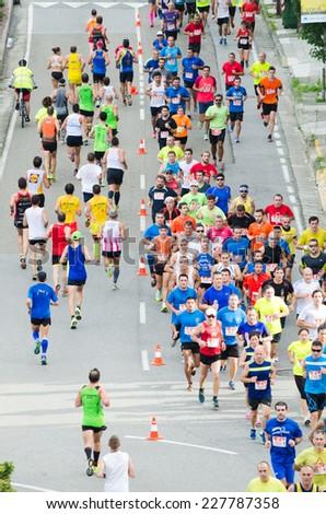 PONTEVEDRA, SPAIN - OCTOBER 19, 2014: Detail of participants in the popular race XVIII Ltd. Half Marathon 2014, held on the streets of the city. - stock photo
