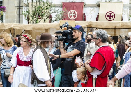 PONTEVEDRA, SPAIN - SEPTEMBER 6, 2014: A man recorded with a video camera, in medieval festival held each year in the historical district of the city.