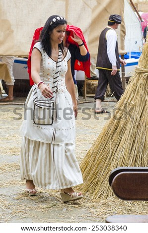 PONTEVEDRA, SPAIN - SEPTEMBER 6, 2014: A woman dressed in medieval dress in medieval festival held each year in the historical district of the city. - stock photo