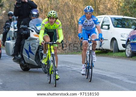 PONTICINO, AREZZO, ITALY - MARCH 08: Diego Caccia and Stefano Pirazzi on the run during the 2nd stage of 2012 Tirreno-Adriatico on March 08, 2012 in Ponticino, Arezzo, Italy - stock photo