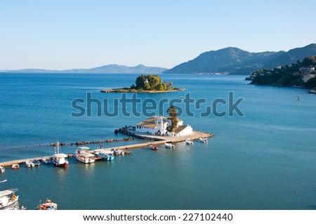 Pontikonisi and Vlacheraina monastery seen from the hilltop of Kanoni on the island of Corfu, Greece. - stock photo