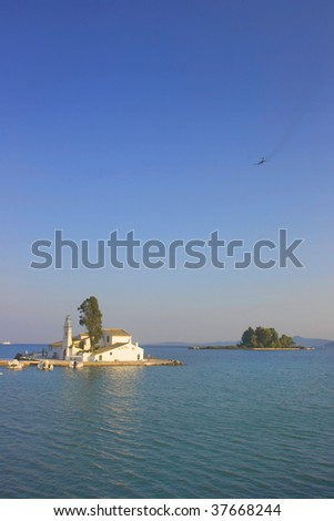 Pontikonisi area at Corfu island with airplane flying , Greece - stock photo