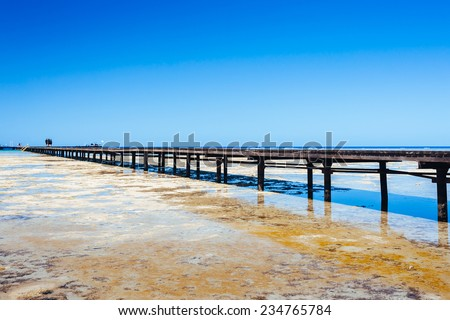 Pontoon bridge at red sea. Beach at a luxury typical unrecognizable 5 star hotel in Egypt, Africa. Holiday resort in Egypt. sharm el sheikh. hurgada. - stock photo