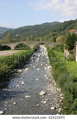 Pontremoli, view of the Magra river, with the medieval stone bridge - stock photo
