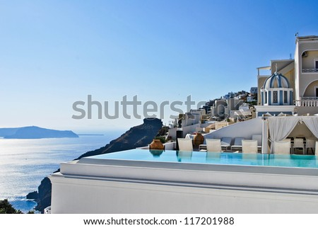 Pool and a view at Santoini - stock photo
