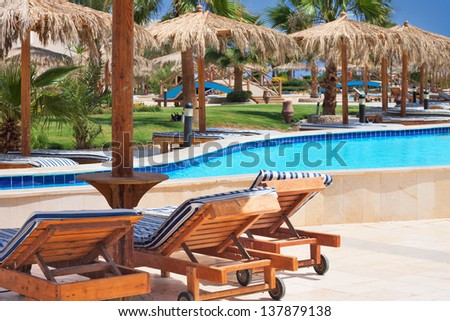 Pool at tropical beach - stock photo