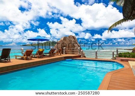 Pool at tropical beach - Seychelles - vacation background - stock photo