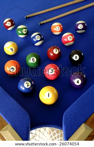 Pool balls on blue table - stock photo