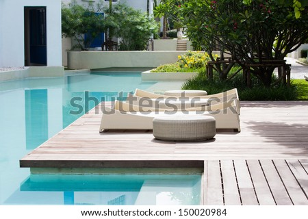 pool bed beside the pool for relax - stock photo