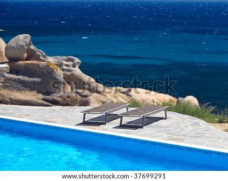 Pool by the Sea, taken in Naxos, Greece - stock photo