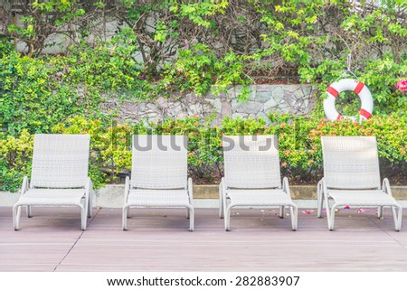 Pool chair with umbrella