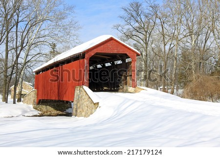 Pool Forge Covered Bridge with snow in Lancaster County, Pennsylvania, USA. - stock photo