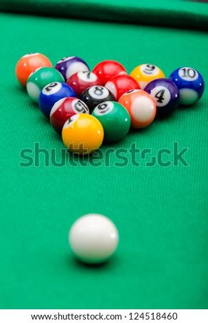 Pool game balls on green felt table - stock photo