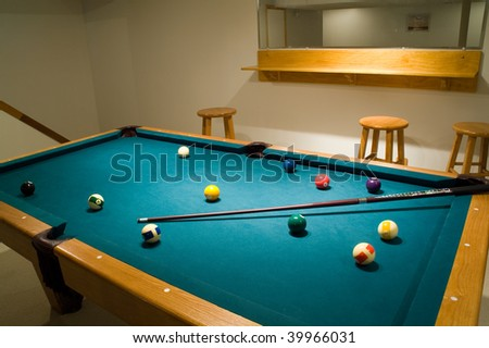 pool in the basement, a little rest during the game - stock photo